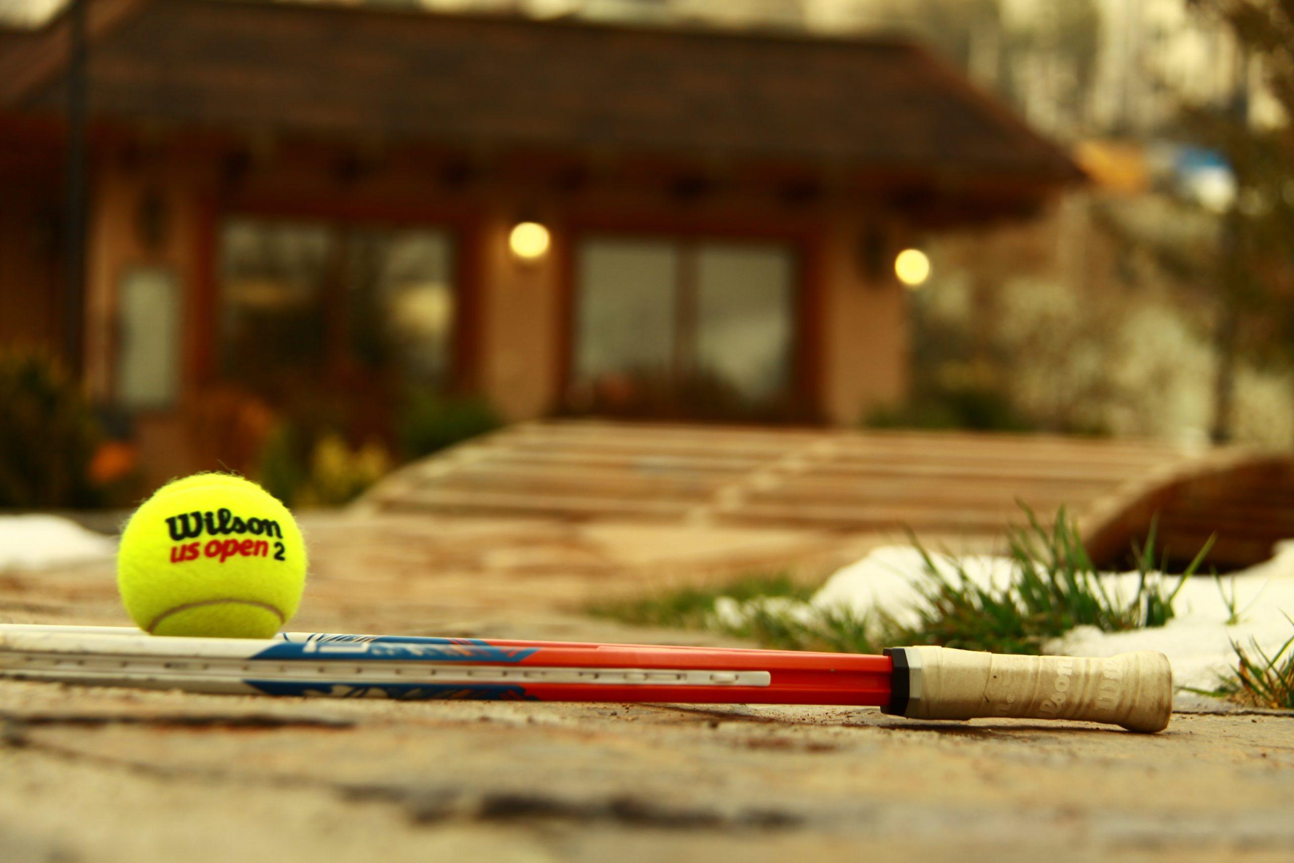 tennis rack and ball