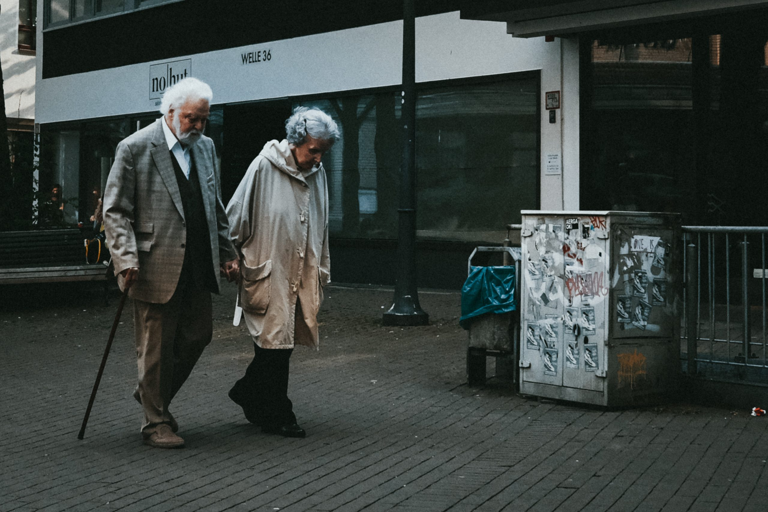 old couple walking holding hands